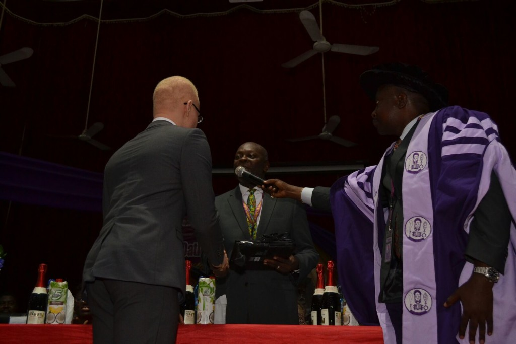 Hafeez Shaka being presented with his new laptop and cash prize from AGHEIF at the University of Benin Medical School Oath-taking Ceremony on 23rd September 2015.
