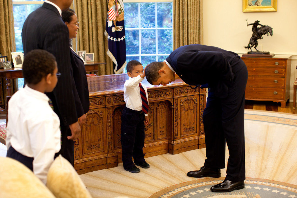 Little boy touching Barack Obama's Hair